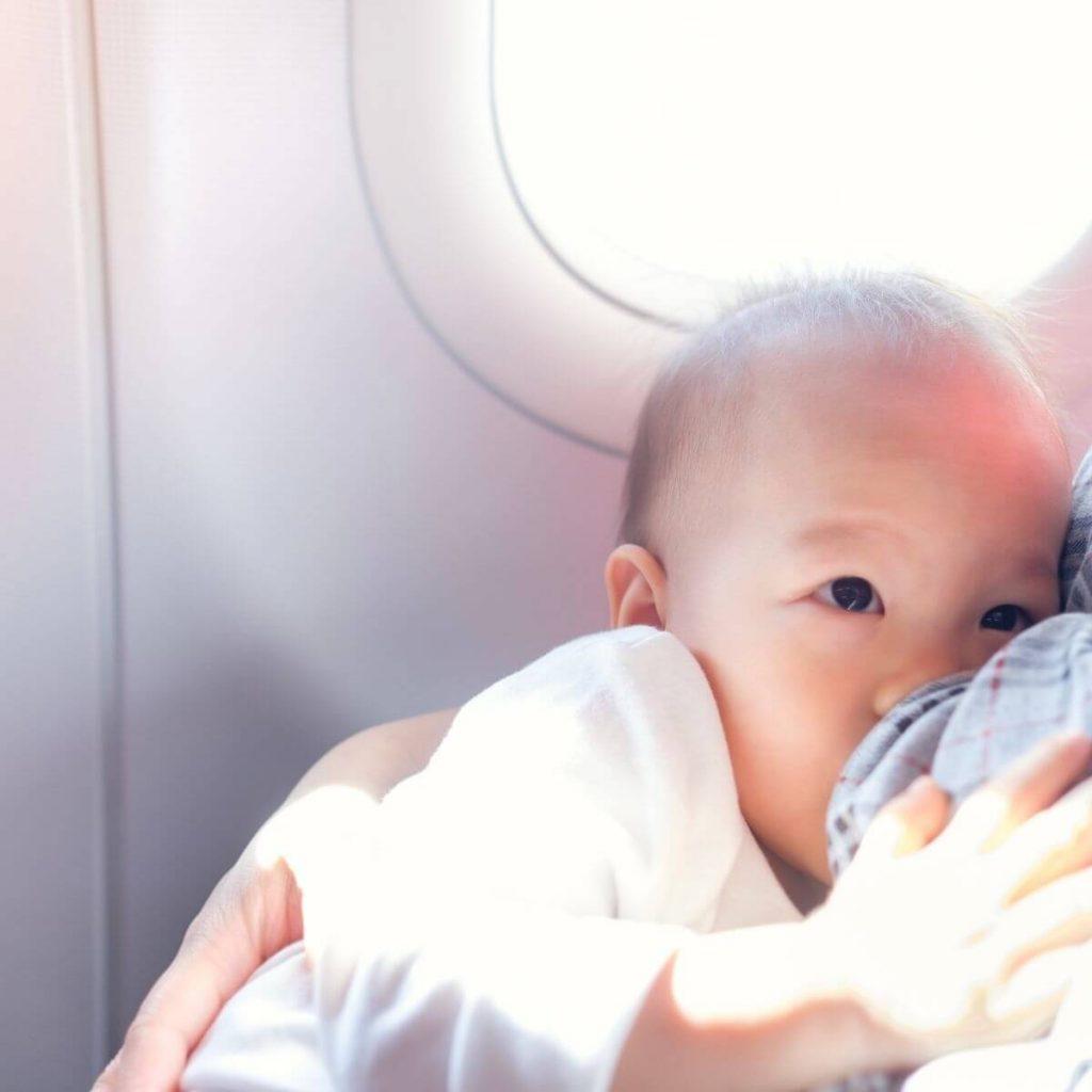 Breastfeeding baby on a plane