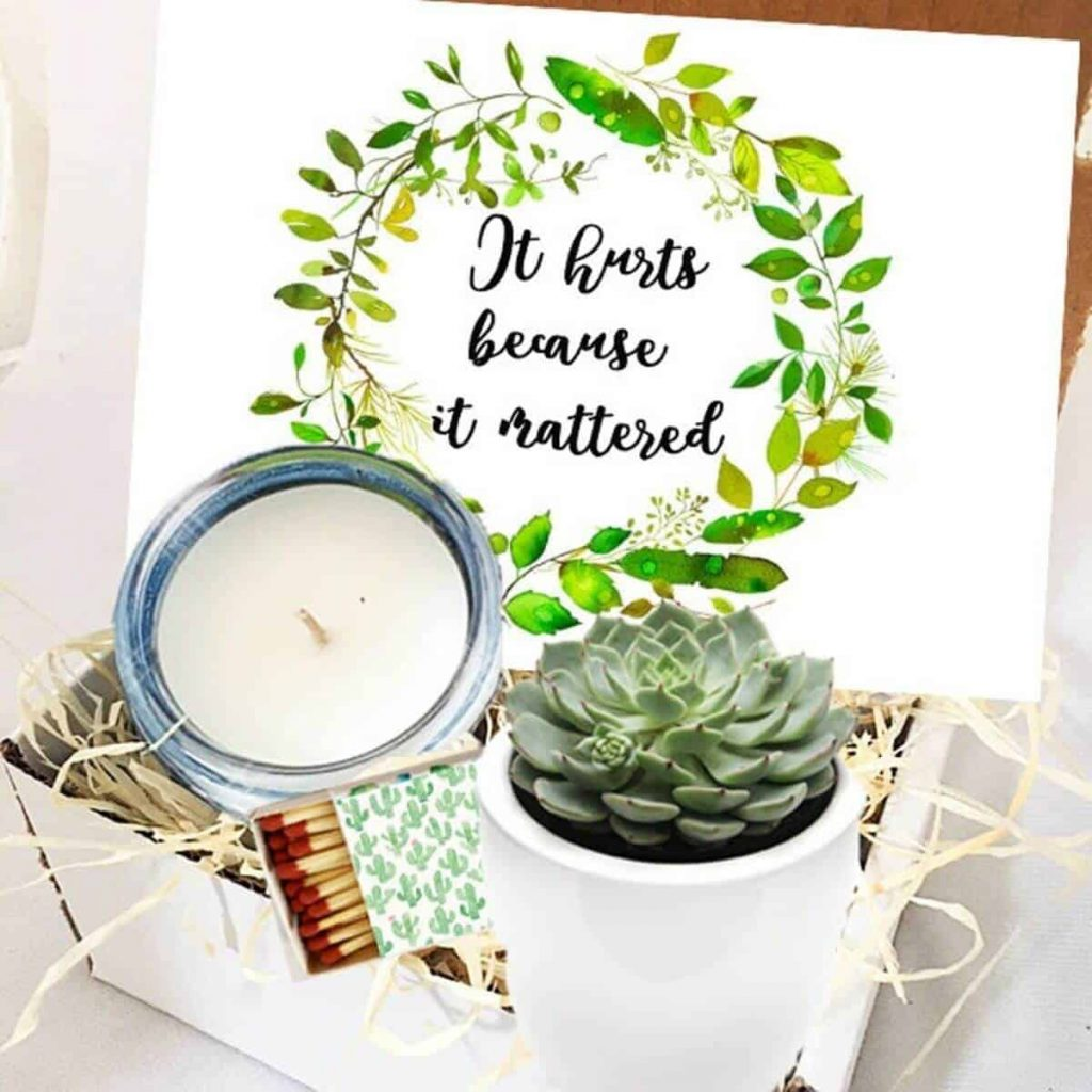 gift box with a candle, matches, a green succulent, and a beautiful print that says it hurts because it matters