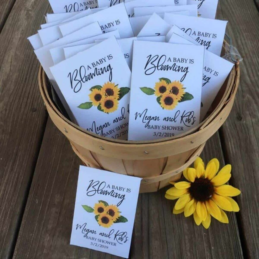 wooden basket with customized seed packets with sunflowers on the front to use as a baby shower favor