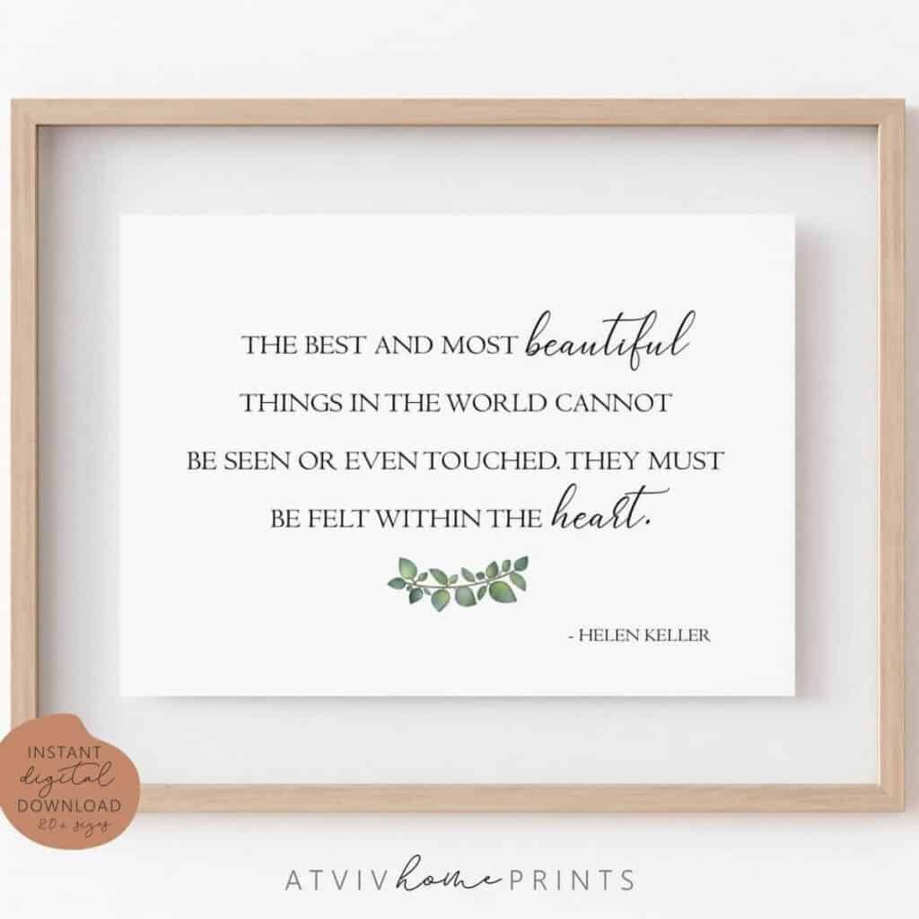 Wooden frame encompassing a printable quote by helen keller that says the best and most beautiful things in the world cannot be seen or even touched. They must be felt within the heart.