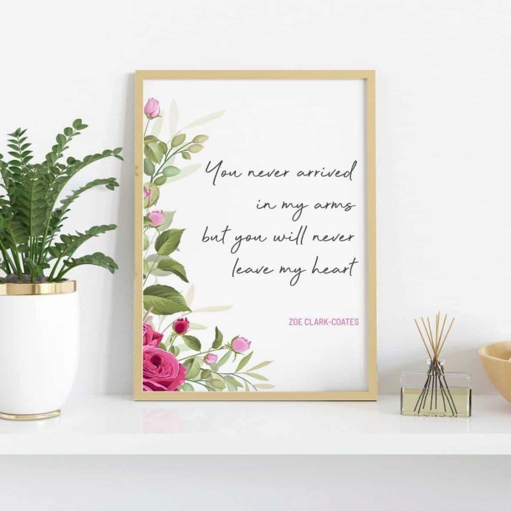 Beautiful gold frame with soft flowers on side sitting on a book shelf with a printable quote photo that says you never arrived in my arms but you will never leave my heart