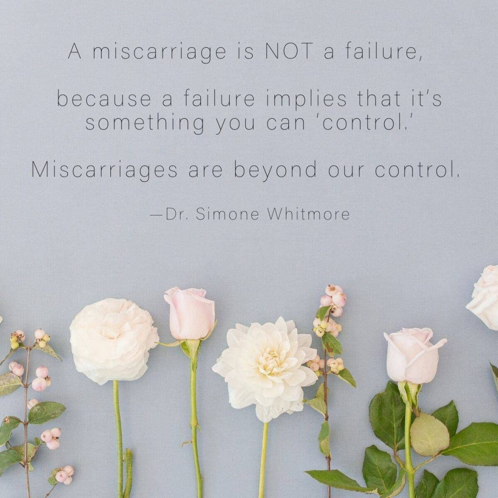 Soft florals rest on the bottom of a warm blue-ish gray background with a miscarriage quote by Dr. Simone Whitmore above it A miscarriage is not a failure, because a failure implies that it's something you can 'control.' Miscarriages are beyond our control