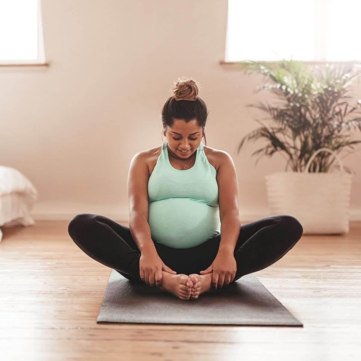 Pregnancy Bloat- Woman doing Yoga