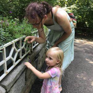 Bonus mom - Thea and girl looking at plant